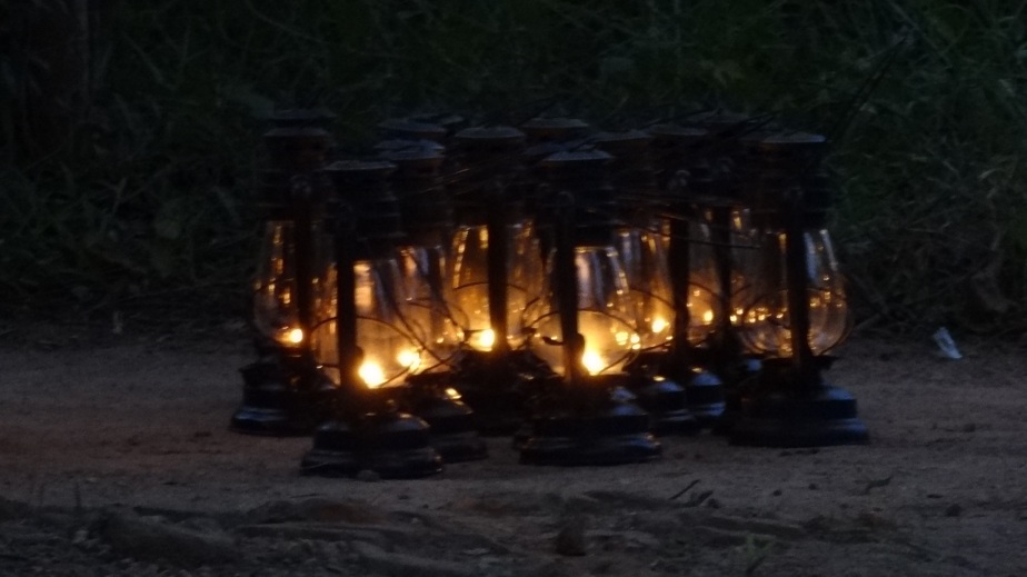 Lanterns being readied to light the pathways in the lodge, as happens every evening