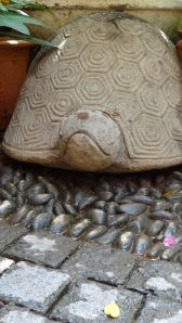 The stone turtle at the entrance to the restaurant
